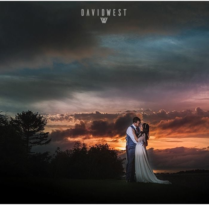 Outdoor sunset wedding at Newton Hall in Northumberland